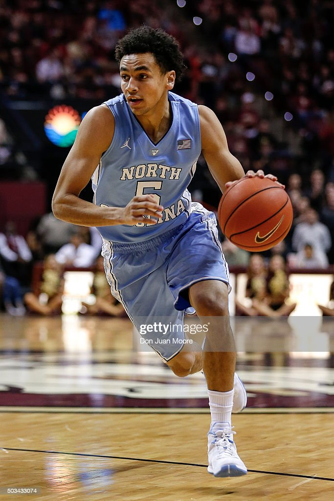 Marcus Paige of the North Carolina Tar Heels drives to the basket during the game against the Florida State Seminoles at the Donald L Tucker Center...