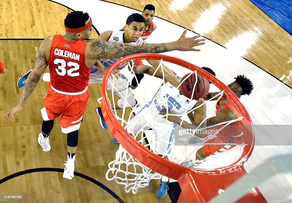 Marcus Paige of the North Carolina Tar Heels drives to the basket against DaJuan Coleman of the Syracuse Orange in the first half during the NCAA...