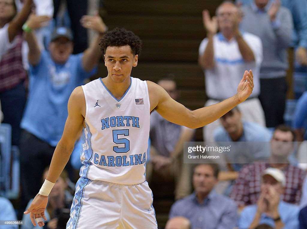Marcus Paige of the North Carolina Tar Heels encourages the crowd to stand and cheer during their game against the Maryland Terrapins at the Dean...