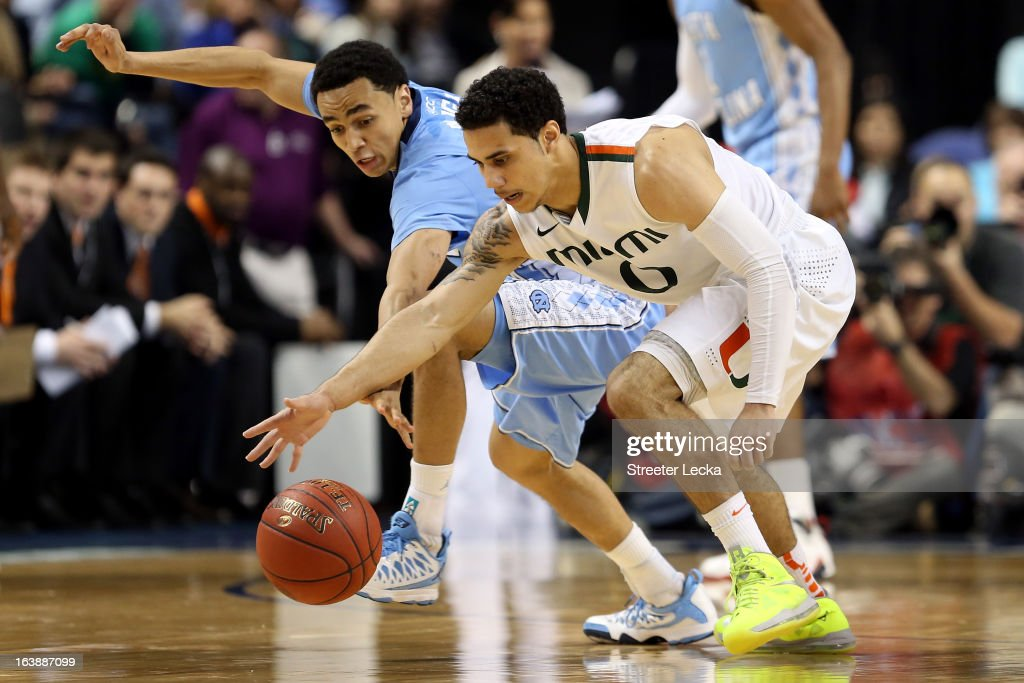 Marcus Paige #5 of the North Carolina Tar Heels fights for a looseball in the second half against Shane Larkin #0 of the Miami (Fl) Hurricanes during the final of the Men's ACC Basketball Tournament at Greensboro Coliseum on March 17, 2013 in Greensboro, North Carolina.
