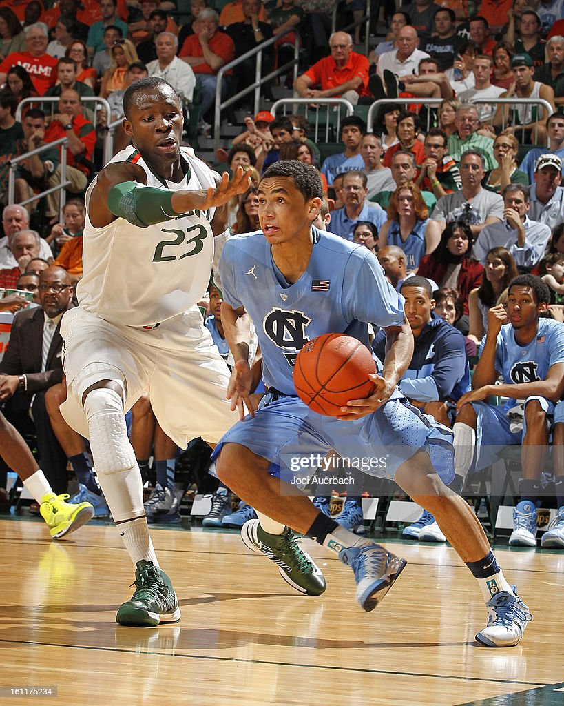Marcus Paige #5 of the North Carolina Tar Heels goes to the basket past Tonye Jekiri #23 of the Miami Hurricanes on February 9, 2013 at the BankUnited Center in Coral Gables, Florida. Miami defeated North Carolina 87-61.