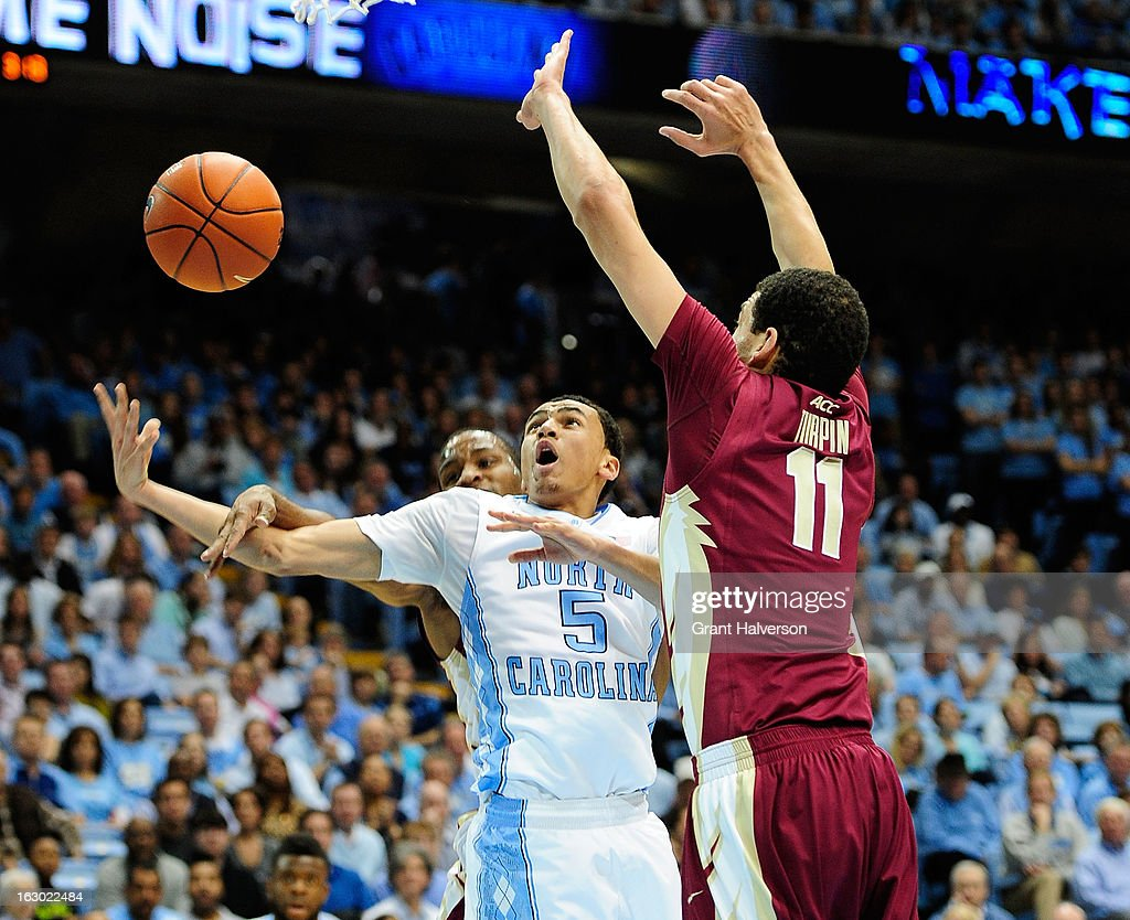 Marcus Paige #5 of the North Carolina Tar Heels is fouled on a drive to the basket during a game against the Florida State Seminoles at Dean Smith Center on March 3, 2013 in Chapel Hill, North Carolina. North Carolina won 79-58.