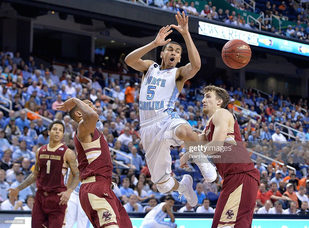 <a gi-track='captionPersonalityLinkClicked' href=/galleries/search?phrase=Marcus+Paige&family=editorial&specificpeople=7880805 ng-click='$event.stopPropagation()'>Marcus Paige</a> #5 of the North Carolina Tar Heels loses the ball as he drives between <a gi-track='captionPersonalityLinkClicked' href=/galleries/search?phrase=Olivier+Hanlan&family=editorial&specificpeople=10135196 ng-click='$event.stopPropagation()'>Olivier Hanlan</a> #21 and Alex Dragicevich #23 of the Boston College Eagles during a second round game of the ACC basketball tournament at Greensboro Coliseum on March 11, 2015 in Greensboro, North Carolina.