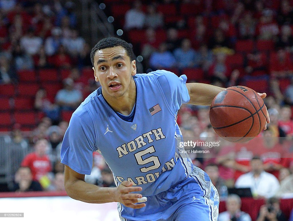 Marcus Paige of the North Carolina Tar Heels moves the ball against the North Carolina State Wolfpack during their game at PNC Arena on February 24...