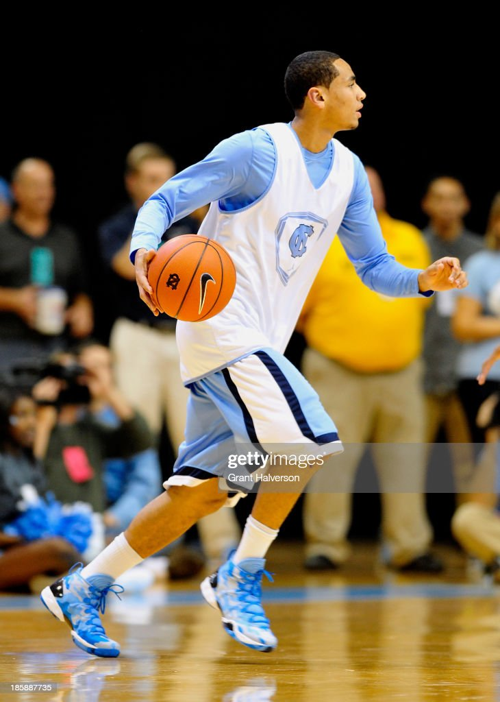 <a gi-track='captionPersonalityLinkClicked' href=/galleries/search?phrase=Marcus+Paige&family=editorial&specificpeople=7880805 ng-click='$event.stopPropagation()'>Marcus Paige</a> #5 of the North Carolina Tar Heels moves the ball during Late Night with Roy Williams at the Dean Smith Center on October 25, 2013 in Chapel Hill, North Carolina.