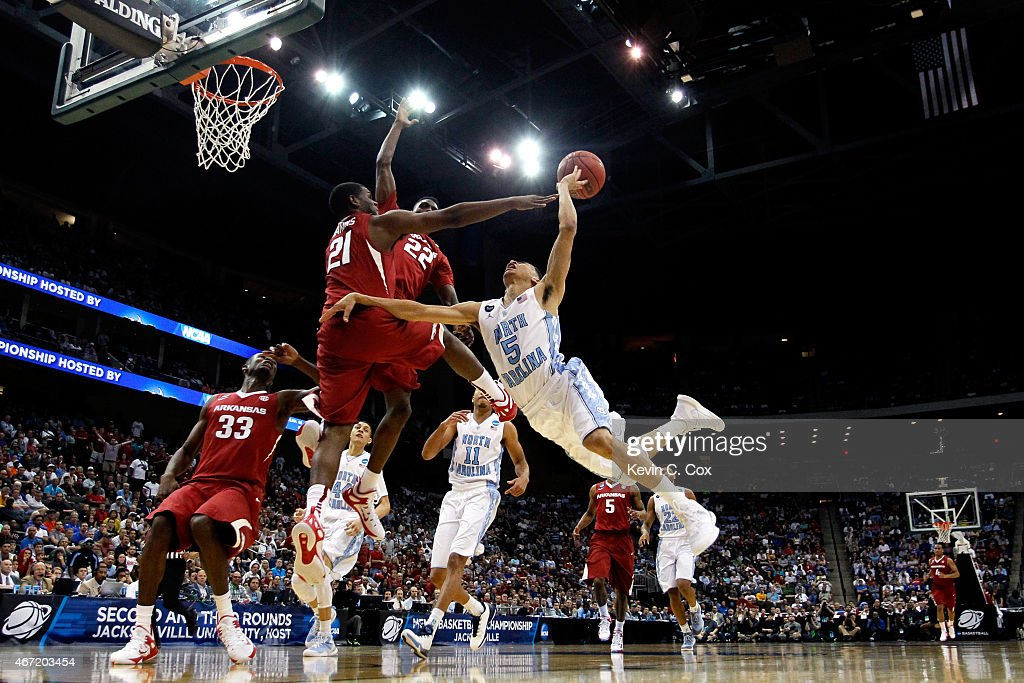 <a gi-track='captionPersonalityLinkClicked' href=/galleries/search?phrase=Marcus+Paige&family=editorial&specificpeople=7880805 ng-click='$event.stopPropagation()'>Marcus Paige</a> #5 of the North Carolina Tar Heels puts up a shot as he is defended by Manuale Watkins #21 of the Arkansas Razorbacks in the second half during the third round of the 2015 NCAA Men's Basketball Tournament at Jacksonville Veterans Memorial Arena on March 21, 2015 in Jacksonville, Florida.