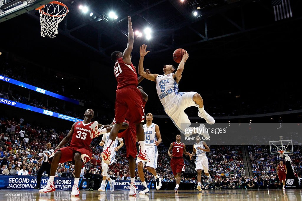 Marcus Paige of the North Carolina Tar Heels puts up a shot as he is defended by Manuale Watkins of the Arkansas Razorbacks in the second half during...
