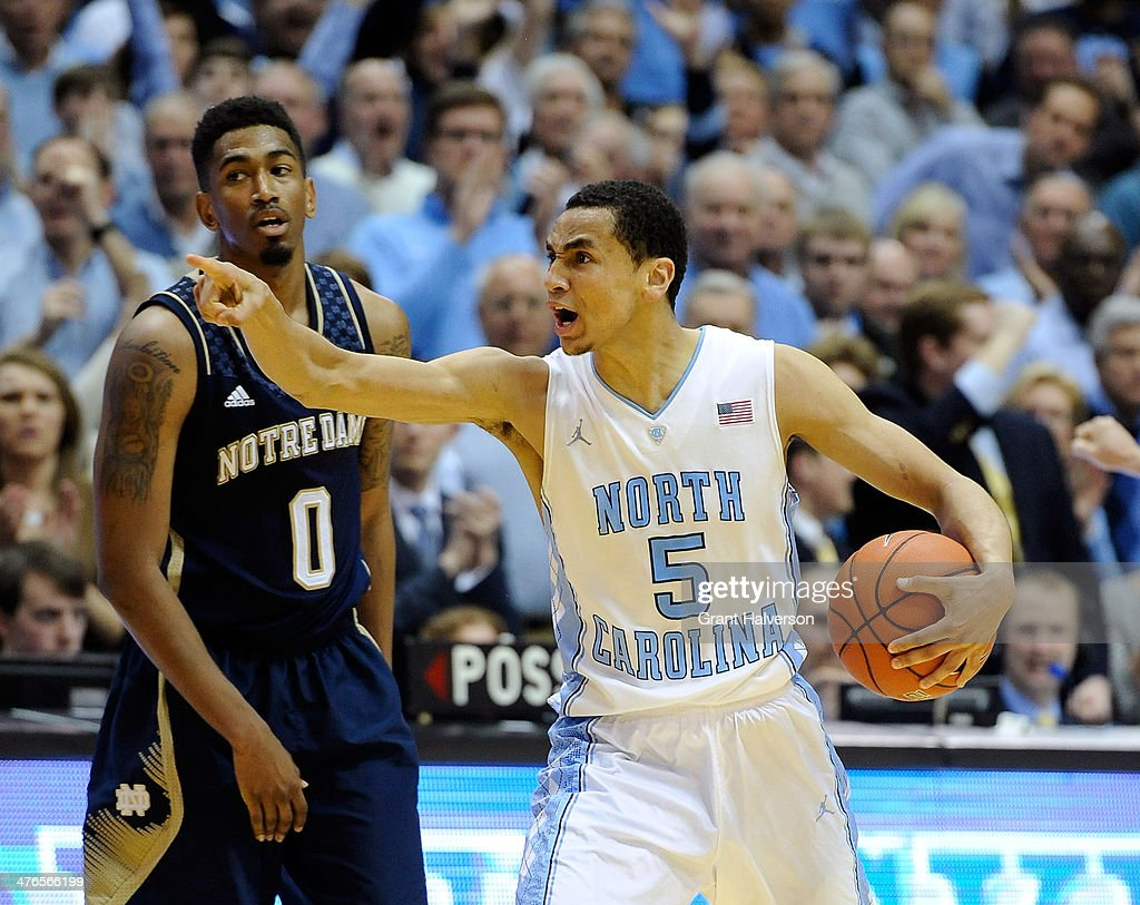 <a gi-track='captionPersonalityLinkClicked' href=/galleries/search?phrase=Marcus+Paige&family=editorial&specificpeople=7880805 ng-click='$event.stopPropagation()'>Marcus Paige</a> #5 of the North Carolina Tar Heels reacts during the final seconds of a win over <a gi-track='captionPersonalityLinkClicked' href=/galleries/search?phrase=Eric+Atkins&family=editorial&specificpeople=7379862 ng-click='$event.stopPropagation()'>Eric Atkins</a> #0 and the Notre Dame Fighting Irish during a game at Dean Smith Center on February 25, 2014 in Chapel Hill, North Carolina. Duke won 66-48.