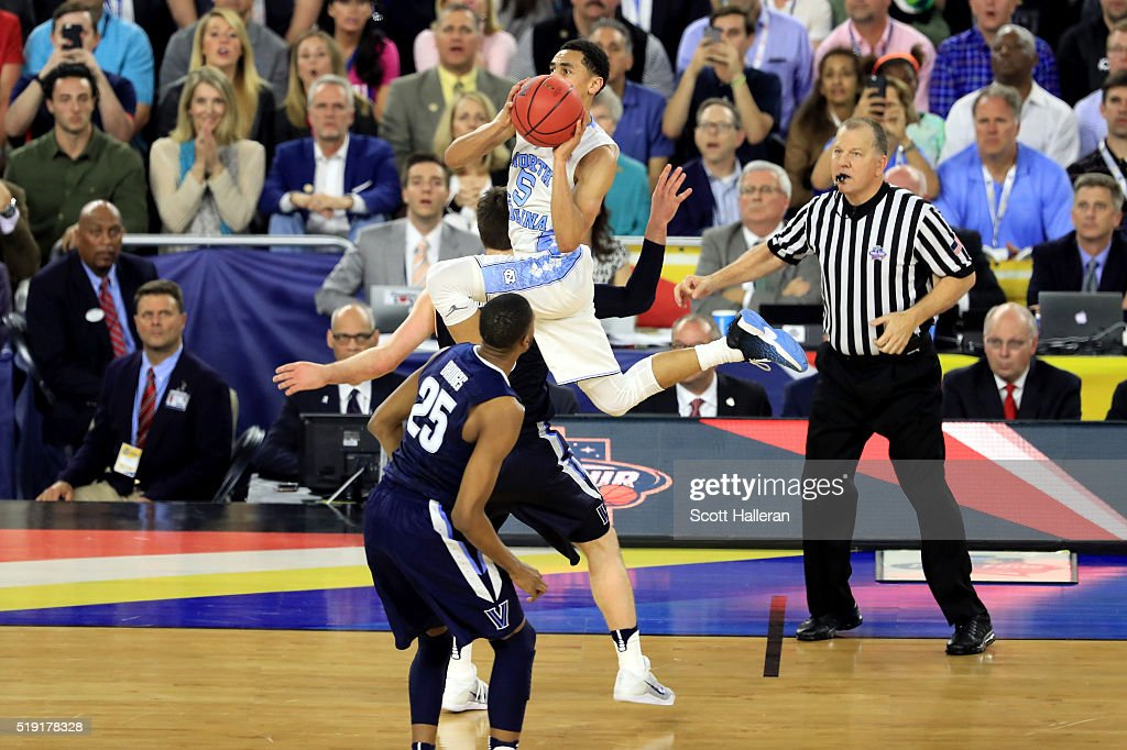 Marcus Paige of the North Carolina Tar Heels shoots a threepointer to tie the game with 47 seconds left in the second half against the Villanova...