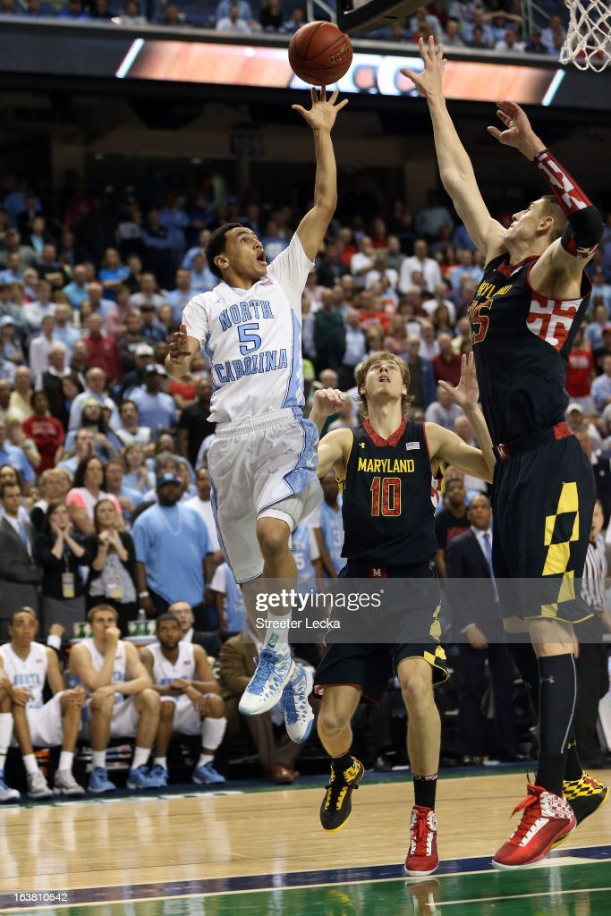 Marcus Paige #5 of the North Carolina Tar Heels shoots over Alex Len #25 of the Maryland Terrapins with under a minute left in the second half during the men's ACC Tournament semifinals at Greensboro Coliseum on March 16, 2013 in Greensboro, North Carolina.