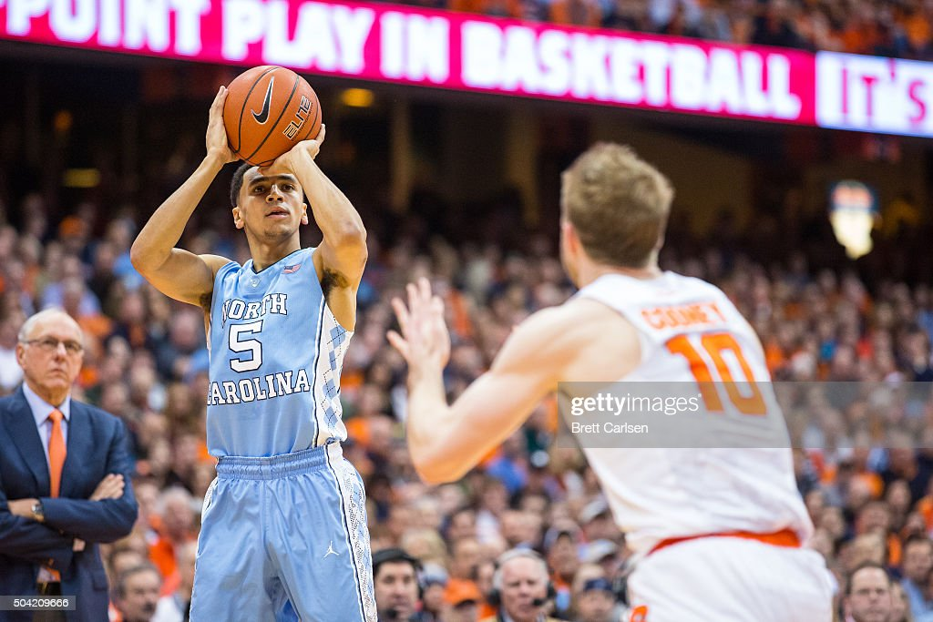 Marcus Paige of the North Carolina Tar Heels shoots the ball as Trevor Cooney of the Syracuse Orange defends during the first half on January 9 2016...