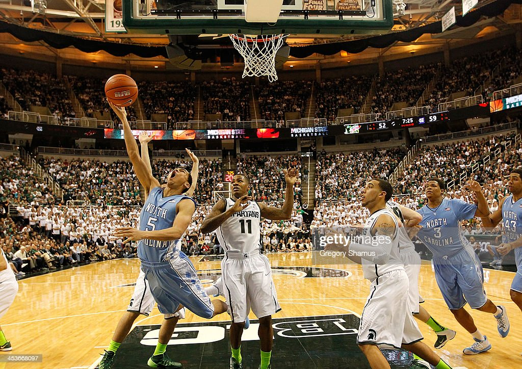 Marcus Paige #5 of the North Carolina Tar Heels tires to get a second half shot off next to Keith Appling #11 of the Michigan State Spartans at the Jack T. Breslin Student Events Center on December 4, 2013 in East Lansing, Michigan. North Carolina won the game 79-65.