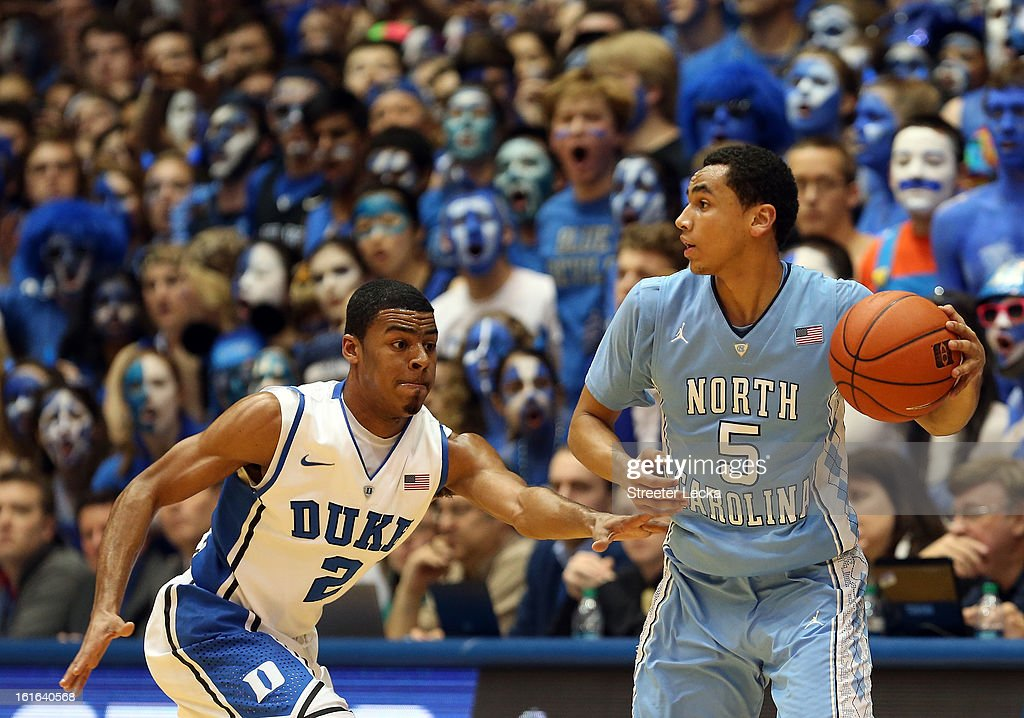 Marcus Paige #5 of the North Carolina Tar Heels tries to keep the ball away from Quinn Cook #2 of the Duke Blue Devils during their game at Cameron Indoor Stadium on February 13, 2013 in Durham, North Carolina.