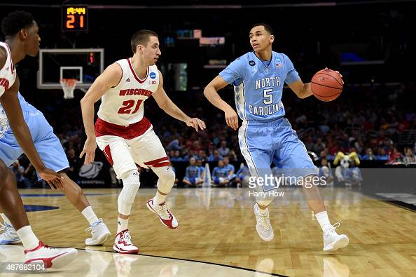 Marcus Paige of the North Carolina Tar Heels with the ball against Josh Gasser of the Wisconsin Badgers in the first half during the West Regional...