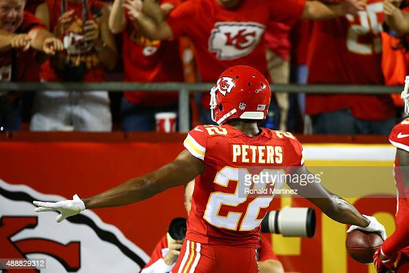 Marcus Peters of the Kansas City Chiefs celebrates after returning an interception for a touchdown against the Denver Broncos at Arrowhead Stadium on...