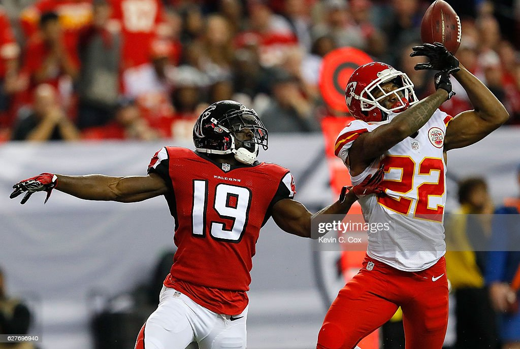 Marcus Peters #22 of the Kansas City Chiefs fails to intercept this touchdown reception intended for Aldrick Robinson #19 of the Atlanta Falcons at Georgia Dome on December 4, 2016 in Atlanta, Georgia.