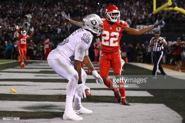 Marcus Peters of the Kansas City Chiefs reacts after a pass interference call in the endzone against Michael Crabtree of the Oakland Raiders during...