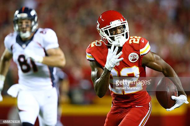 Marcus Peters of the Kansas City Chiefs returns an interception for a touchdown against the Denver Broncos during the game at Arrowhead Stadium on...