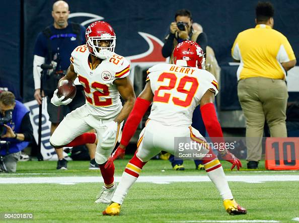 Marcus Peters of the Kansas City Chiefs returns an interception against the Houston Texans in the second quarter during the AFC Wild Card Playoff...