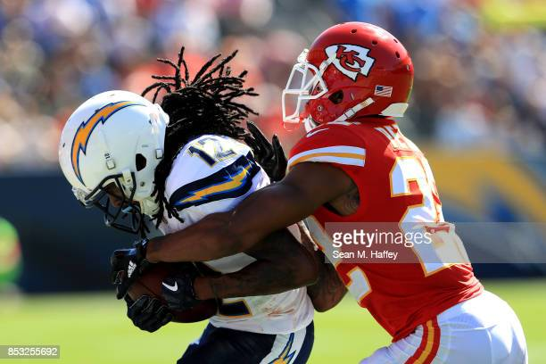 Marcus Peters of the Kansas City Chiefs tackles Melvin Gordon of the Los Angeles Chargers during the first half of a game at StubHub Center on...
