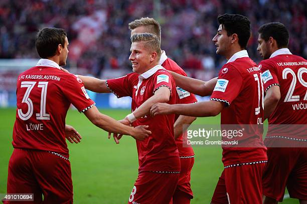 Marcus Piossek of 1 FC Kaiserslautern celebrates with team mates as he scores the opening goal during the Second Bundesliga match between 1 FC...