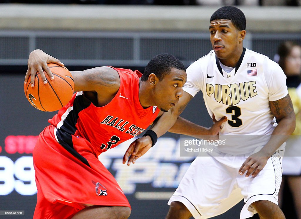 Marcus Posley #3 of the Ball State Cardinals dribbles the ball against Ronnie Johnson #3 of the Purdue Boilermakers at Mackey Arena on December 18, 2012 in West Lafayette, Indiana. Purdue defeated Ball State 66-56.