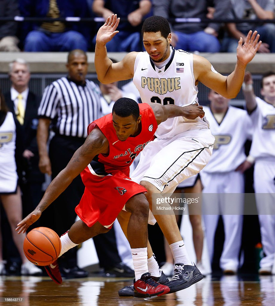 Marcus Posley #3 of the Ball State Cardinals tries to keep control of the ball as A.J. Hammons #20 of the Purdue Boilermakers defends at Mackey Arena on December 18, 2012 in West Lafayette, Indiana. Purdue defeated Ball State 66-56.