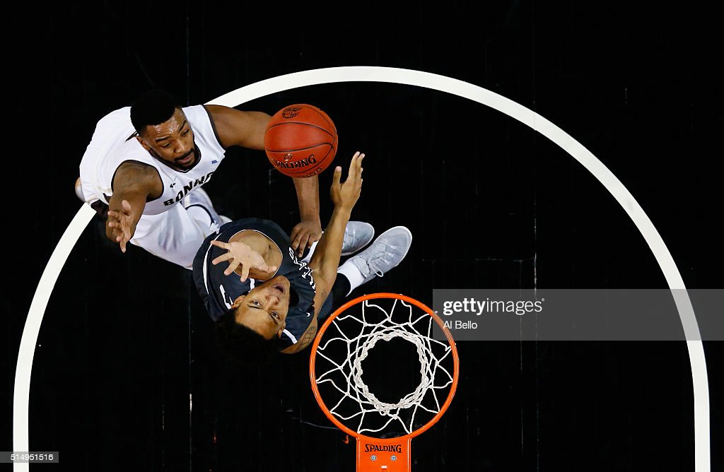 Marcus Posley of the St Bonaventure Bonnies and Jordan Barham of the Davidson Wildcats battle for the ball during the Quarterfinals of the Atlantic...