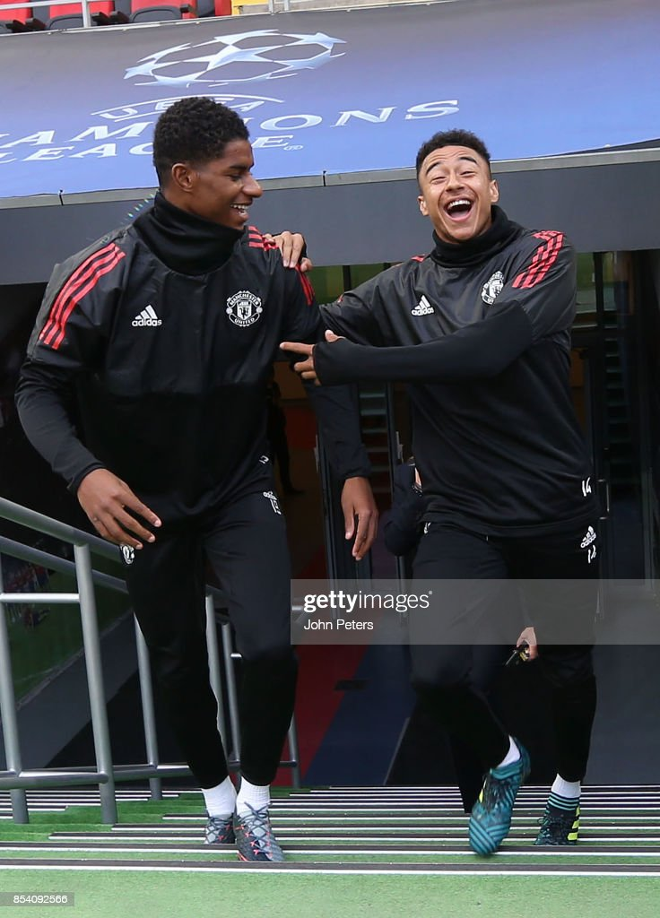 Marcus Rashford and Jesse Lingard of Manchester United walk out ahead of a training session ahead of their UEFA Champions League match against CSKA Moscow at VEB Arena on September 26, 2017 in Moscow, Russia.