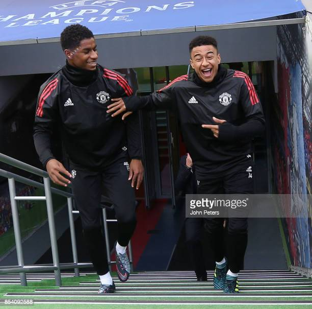 Marcus Rashford and Jesse Lingard of Manchester United walk out ahead of a training session ahead of their UEFA Champions League match against CSKA...