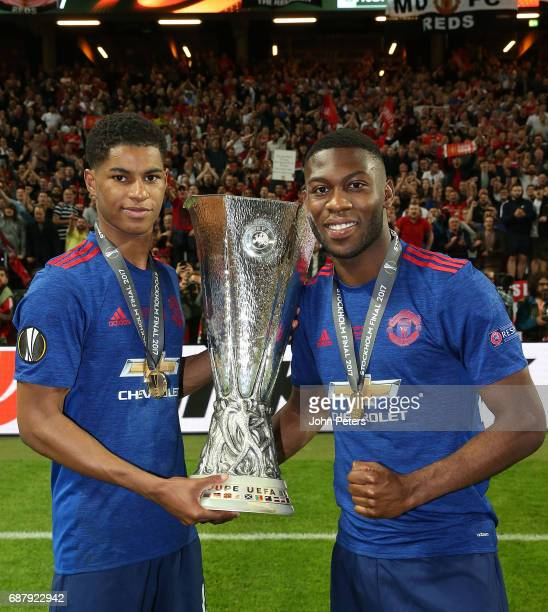 Marcus Rashford and Timothy FosuMensah of Manchester United celebrate with the Europa League trophy after the UEFA Europa League Final match between...