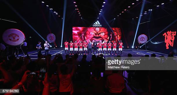 Marcus Rashford Jesse Lingard Henrikh Mkhitaryan Juan Mata Luke Shaw and Manager Jose Mourinho of Manchester United pose during the official launch...