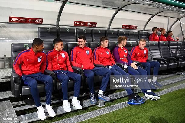 Marcus Rashford Jesse Lingard Michael Keane John Stones Eric Dier and Jordan Pickford of England sit on the bench during a tour of the stadium before...