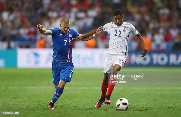 Marcus Rashford of England and Johann Gudmundsson of Iceland compete for the ball during the UEFA EURO 2016 round of 16 match between England and...