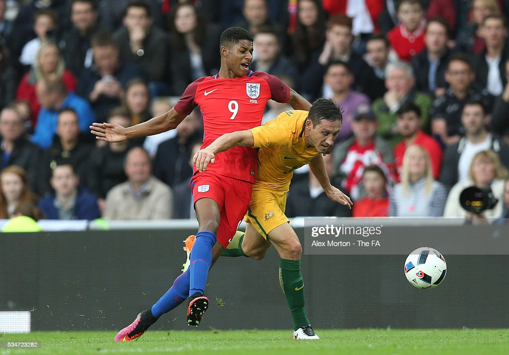 <a gi-track='captionPersonalityLinkClicked' href=/galleries/search?phrase=Marcus+Rashford&family=editorial&specificpeople=13847707 ng-click='$event.stopPropagation()'>Marcus Rashford</a> of England and <a gi-track='captionPersonalityLinkClicked' href=/galleries/search?phrase=Mark+Milligan&family=editorial&specificpeople=557185 ng-click='$event.stopPropagation()'>Mark Milligan</a> of Australia during the International Friendly match between England and Australia at Stadium of Light on May 27, 2016 in Sunderland, England.