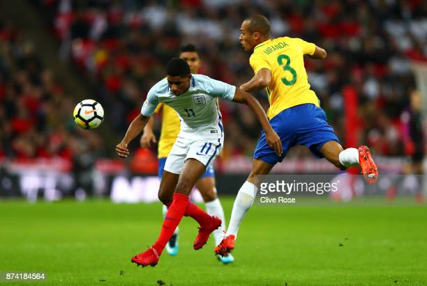 Marcus Rashford of England and Miranda of Brazil battle for possession during the international friendly match between England and Brazil at Wembley...