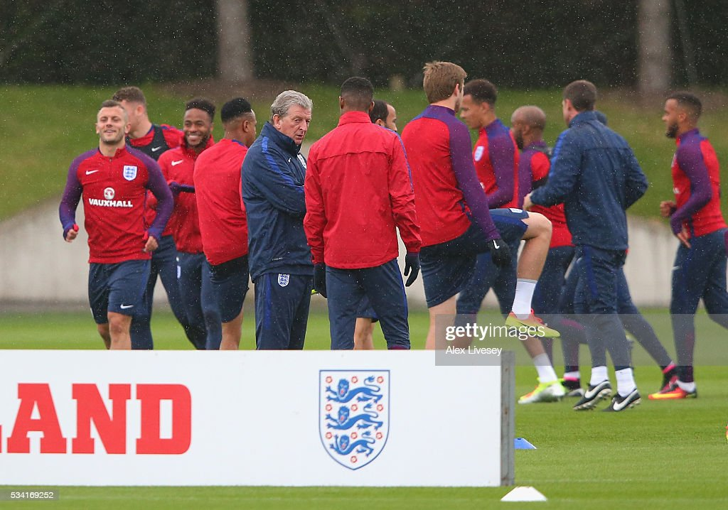 <a gi-track='captionPersonalityLinkClicked' href=/galleries/search?phrase=Marcus+Rashford&family=editorial&specificpeople=13847707 ng-click='$event.stopPropagation()'>Marcus Rashford</a> of England and Roy Hodgeson, Manager of England in conversation during the England training session at Manchester City Football Academy on May 25, 2016 in Manchester, England.