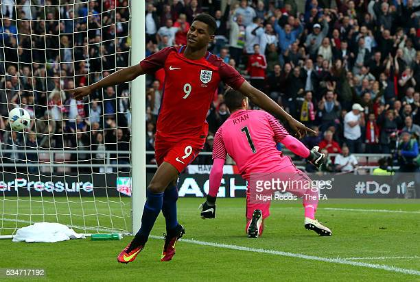 Marcus Rashford of England celebrates scoring the opening goal during the International Friendly match between England and Australia at Stadium of...