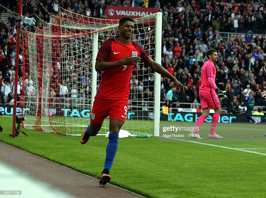 <a gi-track='captionPersonalityLinkClicked' href=/galleries/search?phrase=Marcus+Rashford&family=editorial&specificpeople=13847707 ng-click='$event.stopPropagation()'>Marcus Rashford</a> of England celebrates scoring the opening goal during the International Friendly match between England and Australia at Stadium of Light on May 27, 2016 in Sunderland, England.