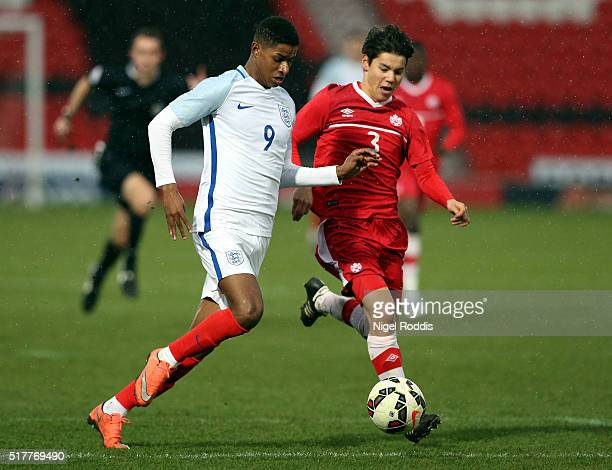 Marcus Rashford of England challenged by Kadin Chung of Canada during the U20 International Friendly match between England and Canada at the Keepmoat...