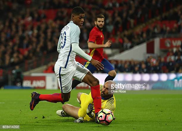 Marcus Rashford of England evades Pepe Reina of Spain during the international friendly match between England and Spain at Wembley Stadium on...
