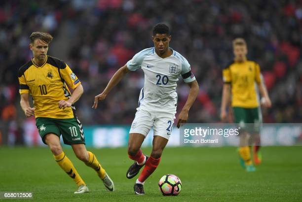 Marcus Rashford of England holds off Arturas Zulpa of Lithuania during the FIFA 2018 World Cup Qualifier between England and Lithuania at Wembley...