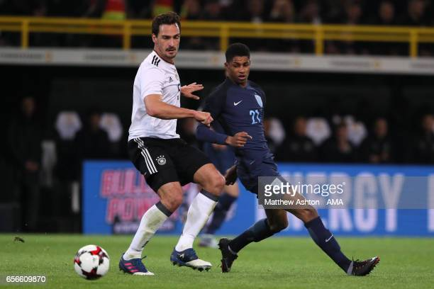 Marcus Rashford of England in action with Mats Hummels of Germany during the international friendly match between Germany and England at Signal Iduna...