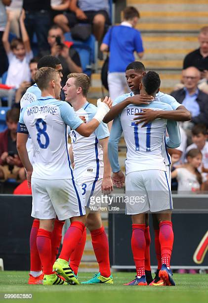 Marcus Rashford of England is congratulated by team mates after scoring the opening goal during the European Under 21 Qualifier match between England...