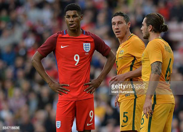 Marcus Rashford of England is tightly marked by Mark Milligan and Joshua Risdon of Australia defence during the International Friendly match between...