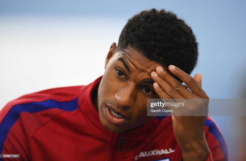Marcus Rashford of England speaks during an England media session at St Georges Park on October 2, 2017 in Burton-upon-Trent, England. England are due to play Slovenia and Lithuania in upcoming World Cup qualifiers.