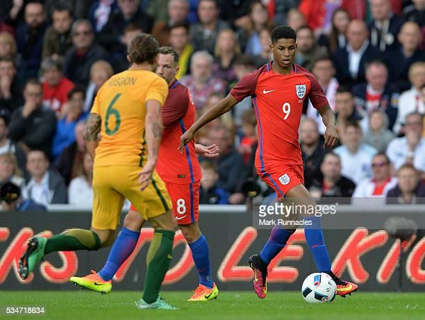 Marcus Rashford of England takes on Joshua Risdon of Australia defence during the International Friendly match between England and Australia at...