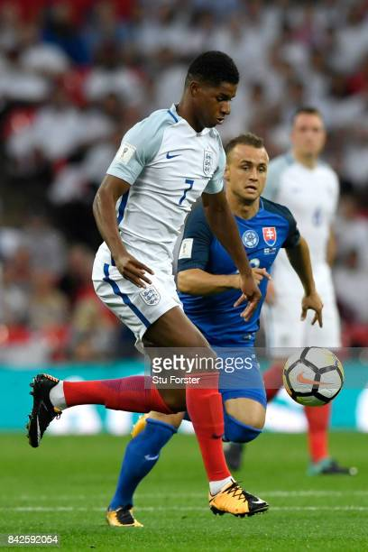 Marcus Rashford of England takes on Stanislav Lobotka of Slovakia during the FIFA 2018 World Cup Qualifier between England and Slovakia at Wembley...