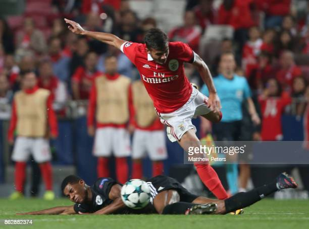 Marcus Rashford of Mancester United in action with Diogo Gonclaves of Benfica during the UEFA Champions League group A match between SL Benfica and...