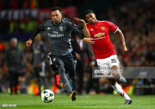 Marcus Rashford of Manchester United and Andreas Samaris of Benfica battle for the ball during the UEFA Champions League group A match between...